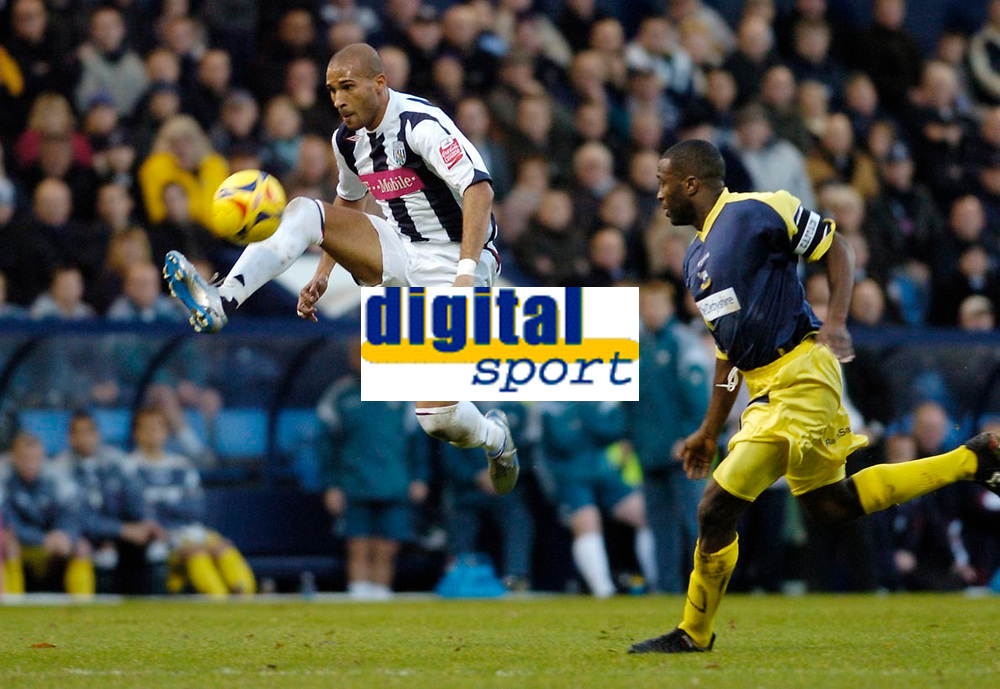 Photo: Leigh Quinnell.<br /> West Bromwich Albion v Derby County. Coca Cola Championship. 02/12/2006. Derbys Michael Johnson can only watch as West Broms  Diomansy Kamara collects the ball.