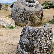 Full (background) and half (foreground) jars at Site 1 of the Plain of Jars in north-central Laos. Much remains unknown about the age and purpose of the thousands of stone jars clustered in the region. Most accounts date them to at least a couple of thousand years ago and theories have been put forward that they were used in burial rituals.