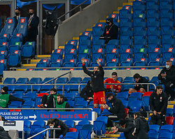 CARDIFF, WALES - Wednesday, November 18, 2020: Wales' captain Gareth Bale celebrates from the bench after the UEFA Nations League Group Stage League B Group 4 match between Wales and Finland at the Cardiff City Stadium. Wales won 3-1 and finished top of Group 4, winning promotion to League A. (Pic by David Rawcliffe/Propaganda)