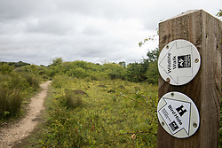 Calvert, UK. 27 July, 2020. A signpost indicates paths to a bird hide and a wildlife walk at Calvert Jubilee Nature Reserve. On 22nd July, the Berks, Bucks and Oxon Wildlife Trust (BBOWT) reported that it had been informed of HS2's intention to take possession of part of Calvert Jubilee nature reserve, which is home to bittern, breeding tern and some of the UK's rarest butterflies, on 28th July to undertake unspecified clearance works in connection with the high-speed rail link.