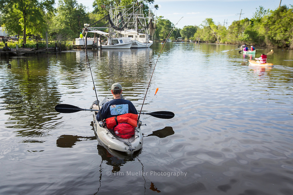 Paddlers participate in Paddle Down Da Bayou Saturday, April 9, 2016. Over 75 people with kayaks, canoes, piroques and stand-up paddle boards paddled a 5-mile stretch of Bayou Petit Caillou in Chauvin, La. The event is sponsored by Terrebonne Advocates for Possibility.