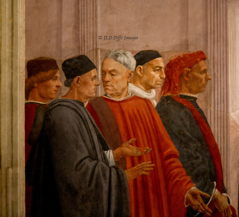 Brancacci Chapel: ...Detail of 'St. Peter Enthroned', showing a group of five men in the audience on the left of the fresco.  One pair are conversing, paying no attention to the event playing before them.