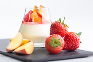 Limoncello flavoured panna cotta with peach coulis pictured at P&O Cruises Development Kitchen for the Macmillan Cancer Support cookery book.<br /> Picture date: Friday April 29, 2016.<br /> Photograph by Christopher Ison ©<br /> 07544044177<br /> chris@christopherison.com<br /> www.christopherison.com
