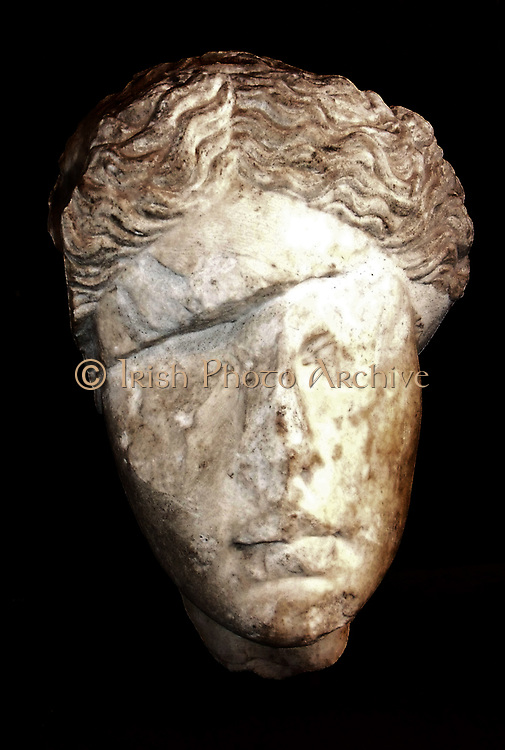 Sculpted head of a woman at the Castel Sant'Angelo in Rome, Italy. Made from Luna Marble. Most likely originally a depiction of divinity (Diana or Venus), but the portrait has been extremely weathered by time. Roman, circa 2nd century AD.
