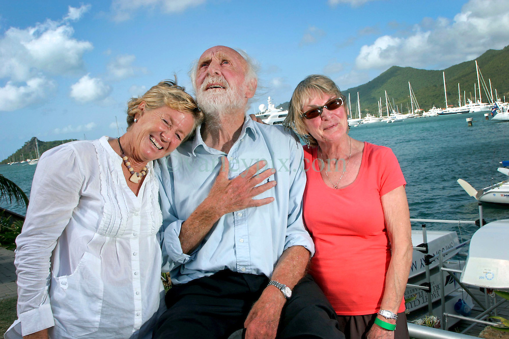 06 April 2011. St Maarten, Antilles, Caribbean.<br /> Anthony Smith, 84 year old British adventurer  arrives in the islands after an epic trans-Atlantic voyage. He is greeted by fellow crew members wives.<br /> L/R Trisha Baily, Anthony Smith, Beryl Russell.<br /> Photo; Charlie Varley/varleypix.com