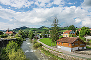 Sitter River in Appenzell village, Switzerland, Europe. Appenzell Innerrhoden is Switzerland's most traditional and smallest-population canton (second smallest by area). Appenzell is known for rural customs and traditions such as the ceremonial descent of cattle in autumn, as well as hiking tours in the scenic Alpstein region.