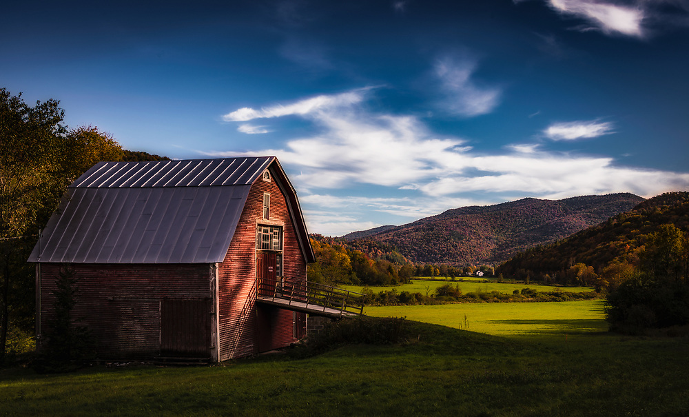 Evening falls on a bucolic scene along the Mad River with the Fall colours resplendent on the Green Mountains