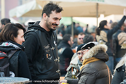 Hanging out in the sun during Motor Bike Expo. Verona, Italy. January 23, 2016.  Photography ©2016 Michael Lichter.