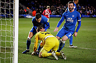 Peterborough Utd midfielder Ben White (6) and Peterborough Utd defender Jason Naismith (2) congratulate Peterborough Utd goalkeeper Conor O'Malley (25) after he saved a penalty during the EFL Sky Bet League 1 match between Peterborough United and Charlton Athletic at London Road, Peterborough, England on 26 January 2019.