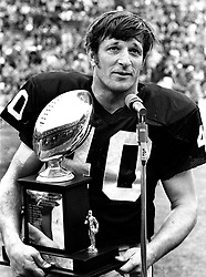 Oakland Raider Pete Banaszak holding award..1975<br />(photo/Ron Riesterer)