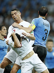 (L-R) Goncali Guedes of Portugal, Cristiano Ronaldo of Portugal, Diego Godin of Uruguay during the 2018 FIFA World Cup Russia round of 16 match between Uruguay and at the Fisht Stadium on June 30, 2018 in Sochi, Russia