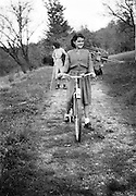 young adult female girl with bicycle rural France 1950s