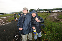 The first day was marred by traffic chaos in the main car parks. Gold car park with Dave McCullow & Danny Muir...T in the Park festival took place on the 6th, 7th and 8 July 2007, at Balado, near Kinross in Perth and Kinross, Scotland. This was the first time the festival had been held over three days..Pic ©2011 Michael Schofield. All Rights Reserved..