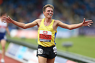Andrew Butchart celebrates as he wins the Men's 5000 metres race to qualify for the Rio 2016 Olympics.The British Championships 2016, athletics event at the Alexander Stadium in Birmingham, Midlands  on Saturday 25th June 2016.<br /> pic by John Patrick Fletcher, Andrew Orchard sports photography.