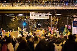6 December 2019, Madrid, Spain: 'How Dare You?' reads a sign overhead as thousands upon thousands of people march through the streets of central Madrid as part of a public contribution to the United Nations climate meeting COP25, urging decision-makers to take action for climate justice.