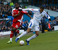 Photo: Steve Bond/Richard Lane Photography. Leeds United v Swindon Town. Coca Cola League One. 14/03/2009. Anthony McNamee (L) is beaten by Jermaine Beckford