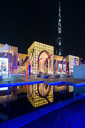 Night view of exterior of Dubai Mall, the world's largest, in Dubai United Arab Emirates