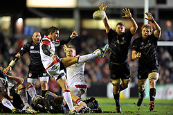 Ruan Pienaar (Ulster) box-kicks the ball clear as Ed Slater and Jamie Gibson (Leicester) attempt to charge him down - Photo mandatory by-line: Patrick Khachfe/JMP - Tel: Mobile: 07966 386802 18/01/2014 - SPORT - RUGBY UNION - Welford Road, Leicester - Leicester Tigers v Ulster Rugby - Heineken Cup.
