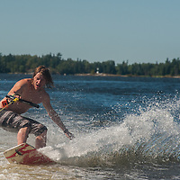 Ben Wiltsie rides a wake skate on Lake of the Woods, Ontario, Canada.