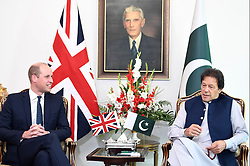 The Duke of Cambridge talks to the Prime Minister of Pakistan Imran Khan during a visit to his official residence in Islamabad on the second day of the royal visit.