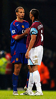 Photo: Daniel Hambury.<br />West Ham United v Manchester United. The Barclays Premiership. 27/11/2005.<br />West Ham's Anton Ferdinand and Manchester's United's Rio Ferdinand at the end of the game.