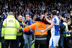 Bristol Rovers' Tom Parkes celebrates Bristol Rovers' win with the fans who invaded the pitch at full time - Photo mandatory by-line: Dougie Allward/JMP - Mobile: 07966 386802 26/04/2014 - SPORT - FOOTBALL - High Wycombe - Adams Park - Wycombe Wanderers v Bristol Rovers - Sky Bet League Two