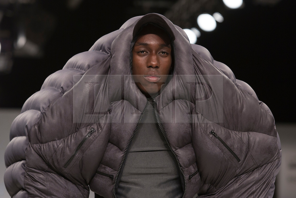 © Licensed to London News Pictures. 30/05/2015. London, UK. A model walks the runway during the Birmingham City University fashion show at Graduate Fashion Week 2015 wearing the collection of graduate student Calum Whitley. Graduate Fashion Week takes place from 30 May to 2 June 2015 at the Old Truman Brewery, Brick Lane. Photo credit : Bettina Strenske/LNP