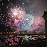VENICE, ITALY - JULY 16:  Fireworks in St Mark's basin at the end of the first day of Redentore celebrations on July 16, 2011 in Venice, Italy. Redentore is one of the most loved celebrations by Venetians which is a remembrance of the end of the 1577 plague. Highlights of the celebration include the pontoon bridge extending across the Giudecca Canal, gatherings on boats in the St Mark's basin and spectacular fireworks on display.
