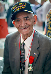 06 June 2014. The National WWII Museum, New Orleans, Lousiana. <br /> WWII veteran pfc Winnie Ancar is presented with the French Legion of Honor medal. <br /> Photo; Charlie Varley/varleypix.com