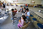 24 JANUARY 2010 -- WENDEN, AZ: Children play chess in the shelter in Salome. Wenden was slammed by its second 100 year flood in 10 years on Thursday night when water raced through Centennial Wash and into the small town in La Paz County west of Phoenix. Most of the town's residents were evacuated to Red Cross shelters in Salome, about 5 miles west of Wenden.   PHOTO BY JACK KURTZ