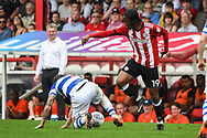 Queens Park Rangers Midfielder Luke Freeman (7) and Brentford Midfielder Romaine Sawyers (19) in action during the EFL Sky Bet Championship match between Brentford and Queens Park Rangers at Griffin Park, London, England on 21 April 2018. Picture by Stephen Wright.