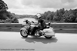 Chris crossing the river near Statesville, NC. 2010<br /> <br /> Limited Edition Print from an edition of 20. Photo ©2010 Michael Lichter.