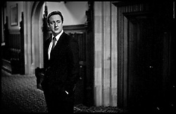 Portraits of the Leader of the Conservative Party David Cameron waits in the corridors of the House Of Commons to address the 1922 committee, 2010. Photo By Andrew Parsons/i-Images