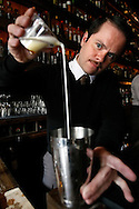 Bar manager, Erick Castro, mixes a Scottish Breakfast cocktail at Rickhouse lounge in San Francisco's Financial District, Tuesday, November 10, 2009. A Scottish Breakfast is a cocktail of apple brandy, scotch, maple syrup, cream and topped with cinnamon.