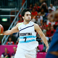 06 August 2012: Argentina Facundo Campazzo passes the ball during 126-97 Team USA victory over Team Argentina, during the men's basketball preliminary, at the Basketball Arena, in London, Great Britain.
