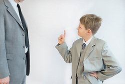 Son blusters his father against white background