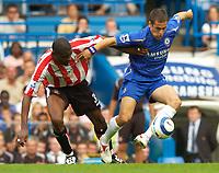 Photo: Henry Browne.<br /> Chelsea v Sunderland. The Barclays Premiership.<br /> 10/09/2005.<br /> Joe Cole of Chelsea fends off Christian Bassila of Sunderland.