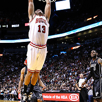 29 January 2012: Chicago Bulls center Joakim Noah (13) dunks the ball during the Miami Heat 97-93 victory over the Chicago Bulls at the AmericanAirlines Arena, Miami, Florida, USA.