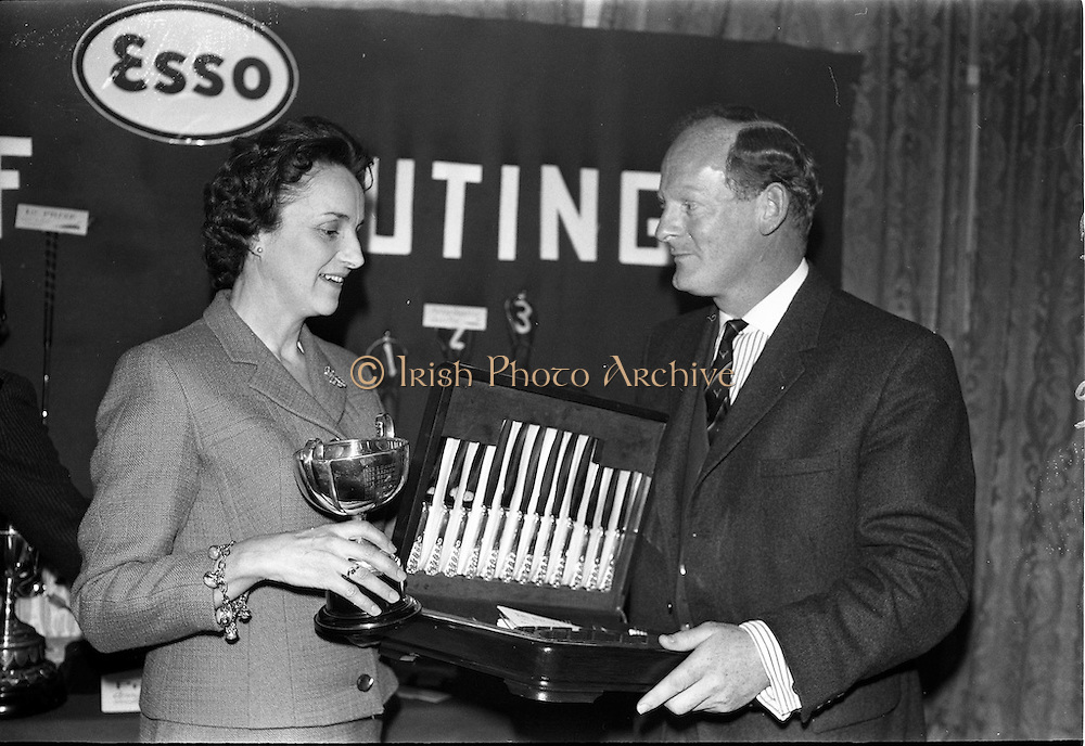 23/05/1963<br /> 05/23/1963<br /> 23 May 1963<br /> Esso Staff Golf Outing at Woodbrook Golf Club, Co. Dublin. Image from the prize giving after the event in the Golf Club. Mrs J. Donovan, wife of Esso Director, John Donovan, on left, presenting the prizes.