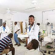 INDIVIDUAL(S) PHOTOGRAPHED: Gimpsly Joaquim. LOCATION: Sacré-Cœur Hospital, Milot Commune, Cap-Haïtien, Haïti. CAPTION: Medical student Gimpsly Joaquim jots down patient information in the emergency room at Sacré-Cœur Hospital.
