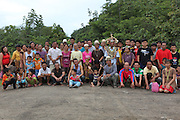 August 2012: Kenyah native people from the communities of Long Lewan standing on a road near their home. They are a community still standing firm against widespread deforestation. Logging companies have to negotiate with them for access and pay to extract timber. The people shown here participated on the actual human blockades during two years continuously from 1991 through 1992. The adults in the front row were children two decades ago. Long Lewan, Belaga district, Sarawak, Borneo<br /> <br /> Home of the Kenyah native people who once lived in Long Geng, which was flooded by the Bakun Dam. Some of this community lives at Long Lewan. The Bakun hydro-electric dam covers 700km². Construction of the dam required the relocation of more than 9,000 native residents, Kenyah indigenous peoples who lived in the flooded area. Many Sarawak natives have been relocated to a longhouse settlement named Sungai Asap in Bakun. Most of them were subsistence farmers. Each family were promised only 3 acres of land, insufficient to survive, and many families still have not been compensated for the loss of their longhouses. Sarawak's primary rainforests have been systematically logged over decades, threatening the sustainable lifestyle of its indigenous peoples who relied on nomadic hunter-gathering and rotational slash & burn cultivation of small areas of forest to survive. Only a few areas of pristine rainforest remain; for the Dayaks and Penan this spells disaster, a rapidly disappearing way of life, forced re-settlement, many becoming wage-slaves. Large and medium size tree trunks have been sawn down and dragged out by bulldozers, leaving destruction in their midst, and for the most part a primary rainforest ecosystem beyond repair. Nowadays palm oil plantations and hydro-electric dam projects cover hundreds of thousands of hectares of what was the world's oldest rainforest ecosystem which had some of the highest rates of flora and fauna endemism, species found there and nowhere else 