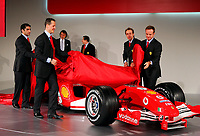 Ferrari drivers Michael Schumacher, second from left, and Rubens Barrichello, right, and Ferrari test drivers Marc Gene (2R), and Luca Badoer (1l) unveil the new F2005 car at the team's headquarters in Maranello<br /> <br /> <br /> <br /> Photo Munch / Graffiti