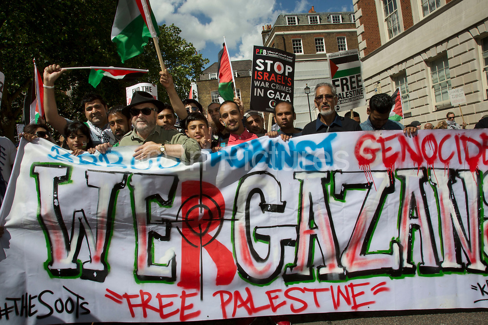 London, UK. Saturday 9th August 2014. British politician George Galloway, Respect Party MP joins the Pro-Palestinian protesters in their tens of thousands march through central London to the American Embassy in protest against the military offensive in Gaza by Israel. British citizens and British Palestinians gathered in huge numbers carrying placards and banners calling to 'Free Palestine' and to 'End the seige on Gaza'.