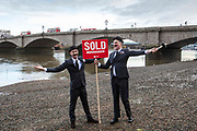 "Oxfam GB Land Grab SOLD Campaign. Oxfam campaigners dressed as investors stage a series of land grabs throughout London, erecting a ""sold"" sign next to various landmarks. Part of Oxfam's ongoing campaign to stop land grabs, which leave poor people in Africa, Asia and Latin America homeless and without access to the land they rely on for food to eat and to make a living."