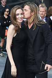 Brad Pitt kisses Angelina Jolie  as they arrive  for the  World War Z premiere in London, Sunday, 2nd June 2013<br /> Picture by Stephen Lock  / i-Images