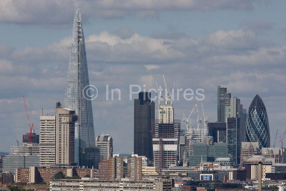 An aerial view of south London looking from Camberwell towards the City and the tall Shard. Fast-rising towers and the newest office blocks climb into the sky in a frenzy of construction, despite during a recession. Standing tallest, is the Shard, a skyscraper completed in May 2012. it is currently the tallest building in the European Union and the 46th-tallest building in the world, standing 310 m (1,017 ft) tall. It is also be the second-tallest free-standing structure in the UK. Several Qatari investors finded the construction of the tower via Islamic finance.