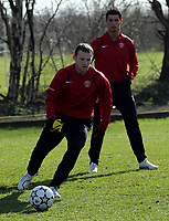 Photo: Paul Thomas.<br />Manchester United training session. UEFA Champions League. 06/03/2007.<br />Man Utd's Wayne Rooney is watched by Cristiano Ronalo during training.