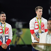 Gymnastics - Olympics: Day 9   Louis Smith #136 of Great Britain, in tears on the podium after winning the silver medal in the Men's Pommel Horse Final with his teammate  Max Whitlock #138 of Great Britain winning the gold medal at the Rio Olympic Arena on August 14, 2016 in Rio de Janeiro, Brazil. (Photo by Tim Clayton/Corbis via Getty Images)