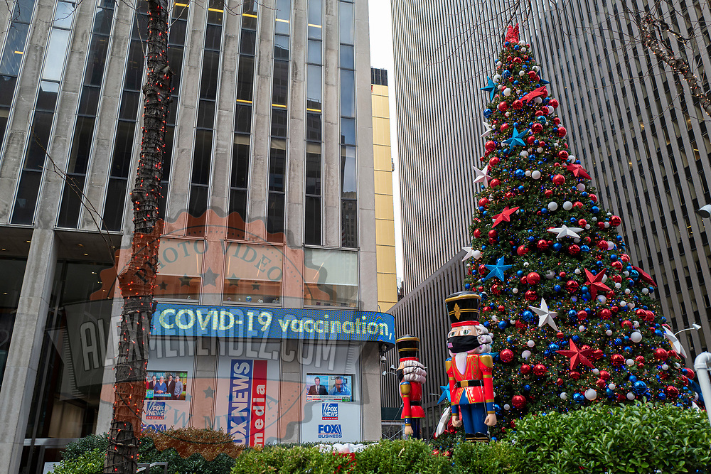The ticker at the Fox News ticker mentions Covid-19 vaccinations during the holiday season with Coronavirus (Covid-19) outbreak in Manhattan, New York on Tuesday, December 8, 2020. (Alex Menendez via AP)