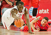 Nov 18, 2013; Fayetteville, AR, USA; Arkansas Razorback forward Alandise Harris (2) reaches for control of a loose ball as Southern Methodist Mustang guard Nic Moore (11) looks on during the first half of a game at Bud Walton Arena. Arkansas defeated Southern Methodist 89-78. Mandatory Credit: Beth Hall-USA TODAY Sports